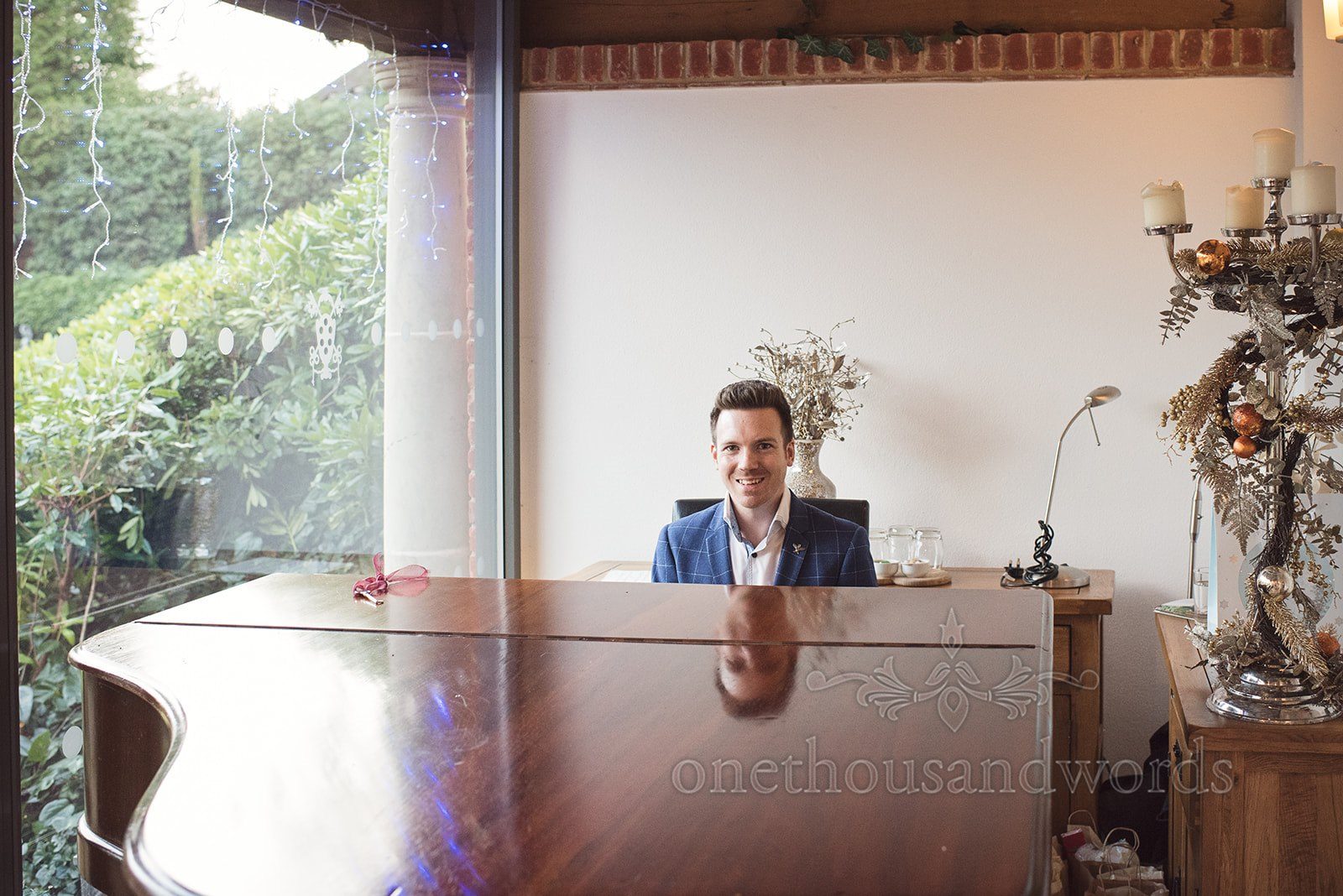 Pianist prepares for Wedding Breakfast Performance - One Thousand Words Photography